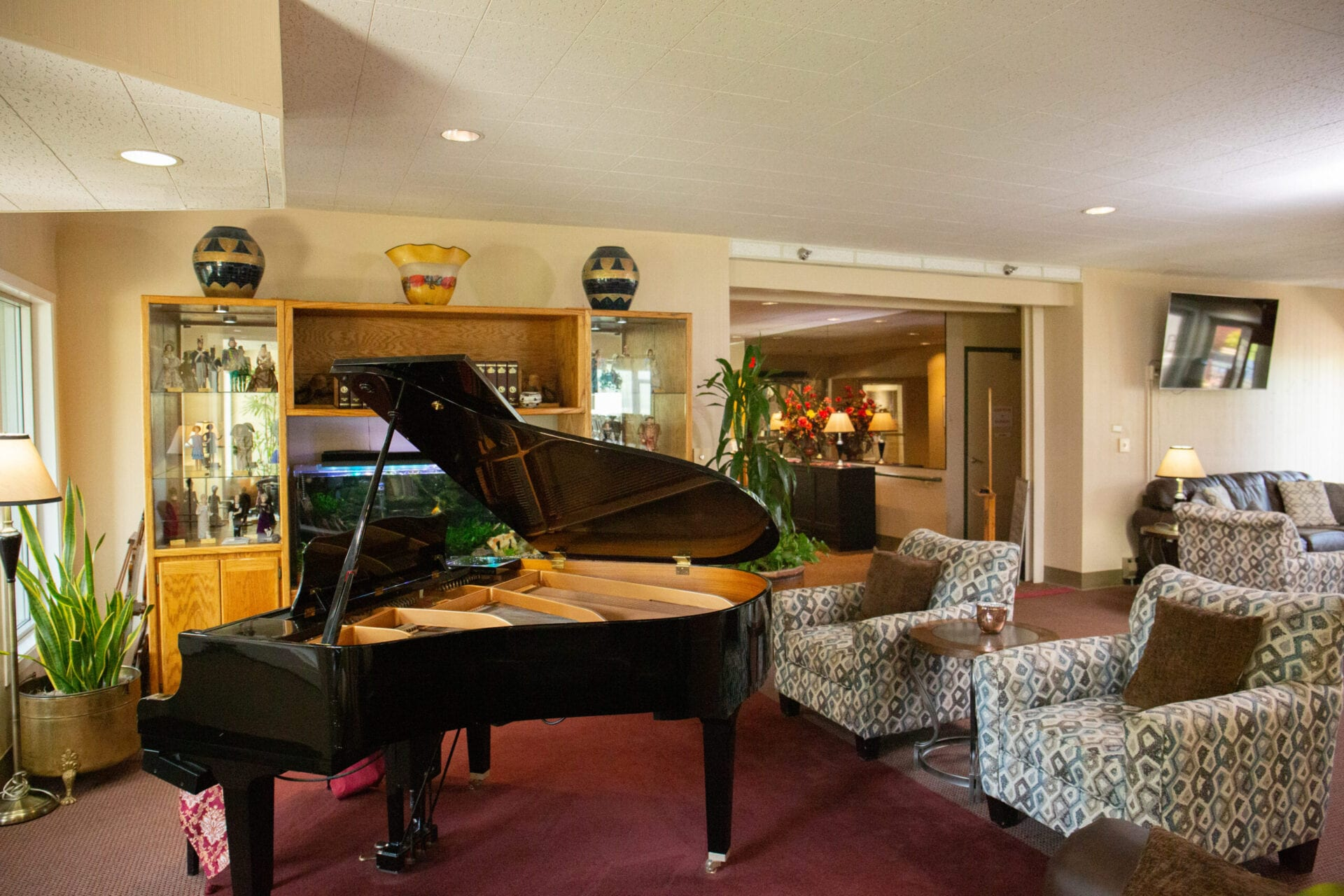 One of the main sitting areas of the facility with a grand piano