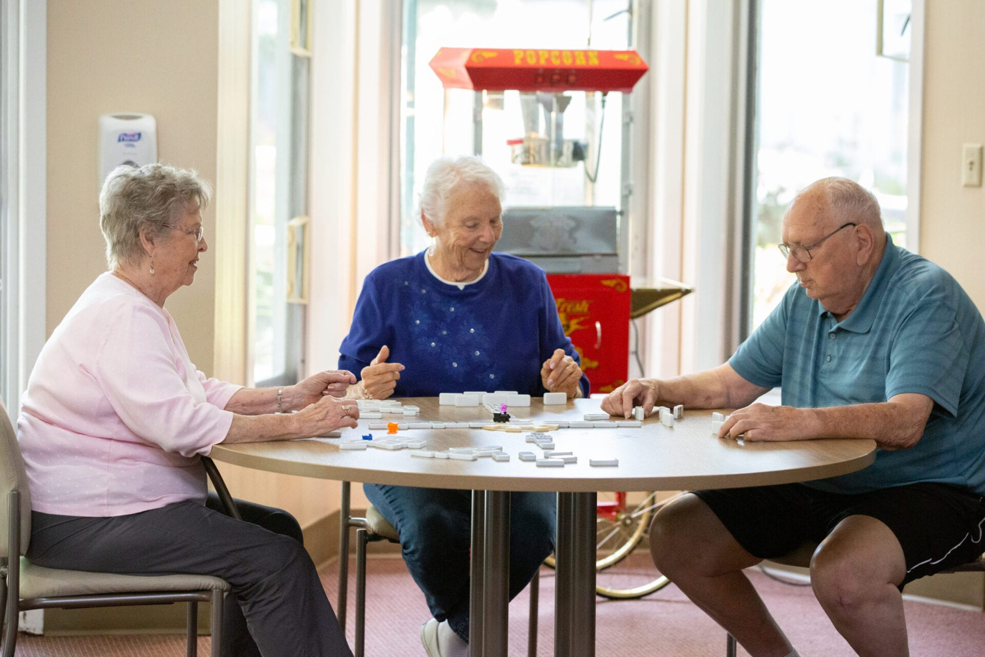 Residents playing dominoes in the game room