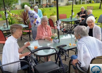 Residents coming together to enjoy the day on the shaded deck
