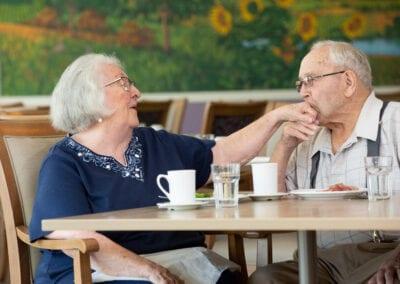 Resident couple having fun in dining