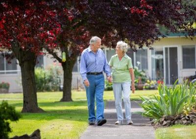 Resident couple walking on the walkway