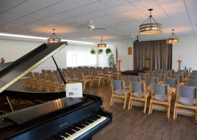 Prayer room with chairs and piano